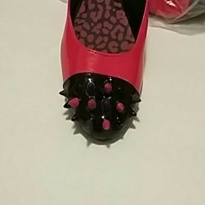 Pink Black Flats with Multi Spikes Design on How a